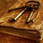 Old metal keys on vintage book.